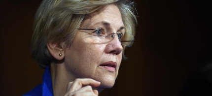 Senator Elizabeth Warren, D-Mass., defended Vermont independent Senator Bernie Sanders from criticism by Goldman Sachs on Wednesday. Pictured: Warren listens during a hearing of the Senate Health, Education, Labor, and Pensions Committee on July 29, 2015 in Washington, D.C. (photo: Astrid Riecken/Getty)
