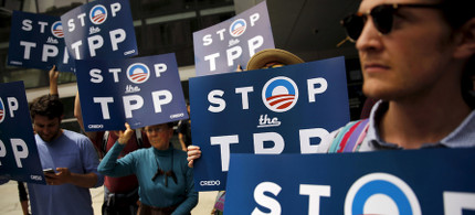 TPP protesters. (photo: Robert Galbraith/Reuters)