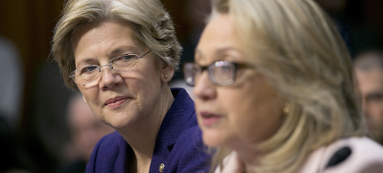 Senator Elizabeth Warren looks on as then Secretary of State Hillary Clinton speaks during a Senate Foreign Relations Committee nomination in 2013. (photo: Getty Images)