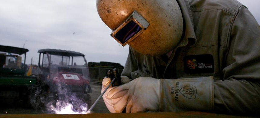 A welder works in Port Fourchon, Louisiana, May 3, 2010. (photo: Sean Gardner/Reuters)