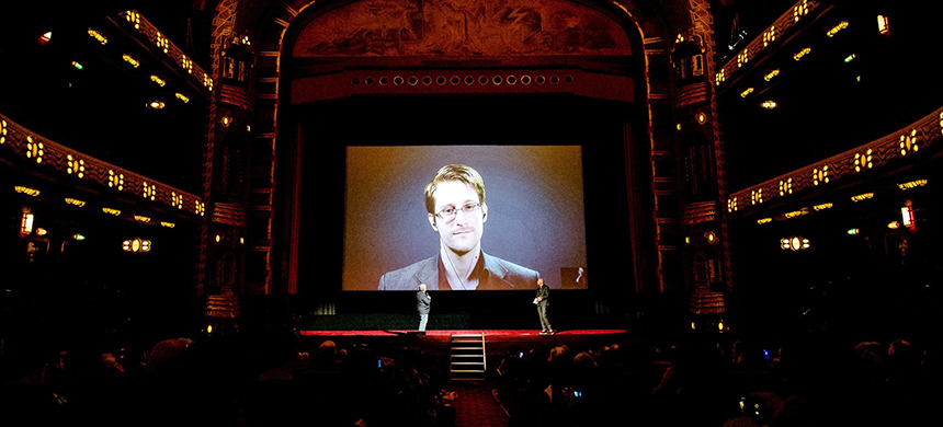 Edward Snowden speaks at a Q&A in Amsterdam via a livestream connection from Russia on November 10, 2016. (photo: Sander Koning/AFP/Getty Images)