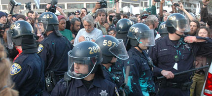 Oakland Police officers strike a defensive position after attacking protesters with truncheons, 10/25/11. (photo: Marc Ash/RSN)