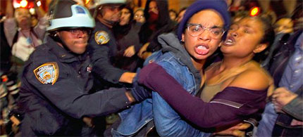 Occupy Wall Street activists are forcibly removed by New York City Police from Liberty Plaza, 11/15/11. (photo: Lucas Jackson, Reuters)