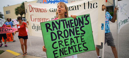 Medea Benjamin of Code Pink protests in August outside a building in Florida where drones are built. (photo: Joe Raedle/Getty Images)