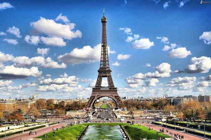 """Long view of Eiffel Tower on a sunny day, from the end of Trocadero Fountain takes in some of the city. A student thought Yeats's """"Sailing to Byzantium"""" country might be here."""