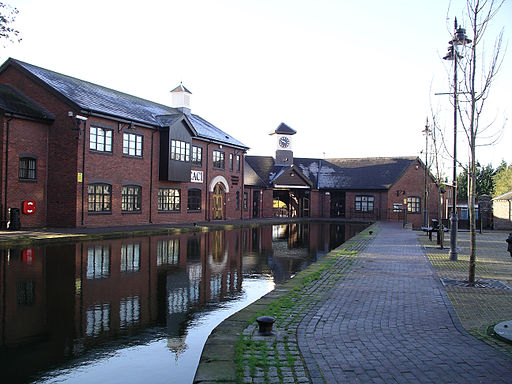 Red brick buildings surrounding southern basin of Coventry canal. Coventry possible model for Eliot's Middlemarch.