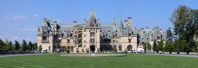 Wide-angle photograph showing entire elevation of Biltmore mansion, near Asheville, NC. In the style of a French chateau.