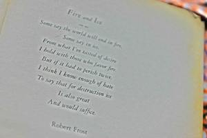"""Photo of page of book showing Frost's poem """"Fire and Ice"""""""