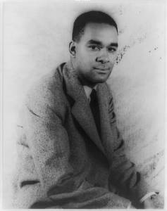 B & W Photo of American Modernist Writer Richard Wright. 3/4 profile, short hair, wearing soft sports coat.