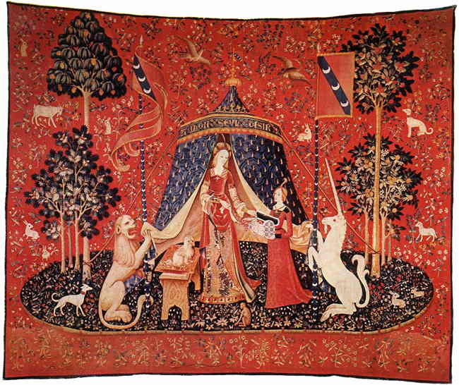 Large red tapestry depicting a lady and her servant, flanked by a lion, a unicorn, and multiple trees and animals, illustrating the magical realm of the Medieval Romance.