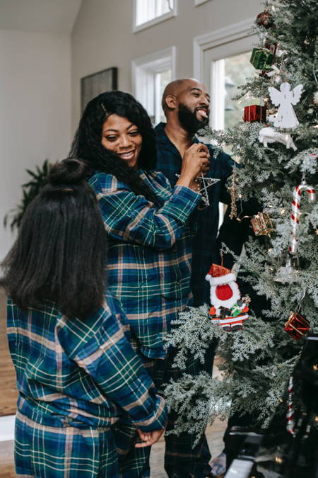 A quiet family Christmas-decorating the tree in flannel PJs.