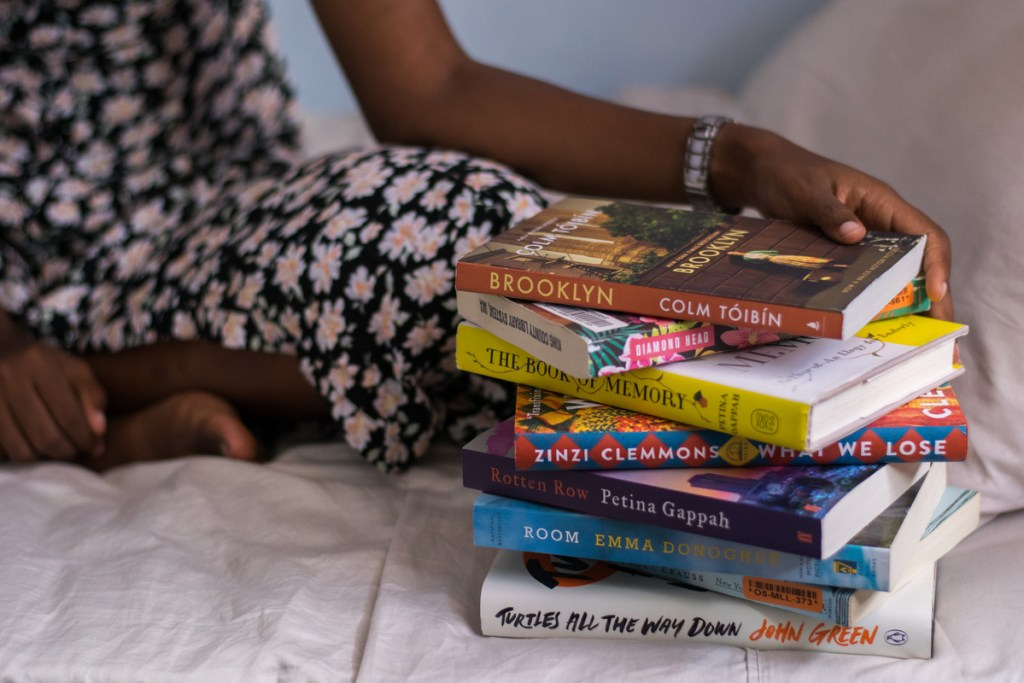 Stack of books on the bed