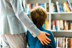 child and mother in library looking at books_reduced