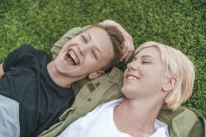 mom and son laughing outside