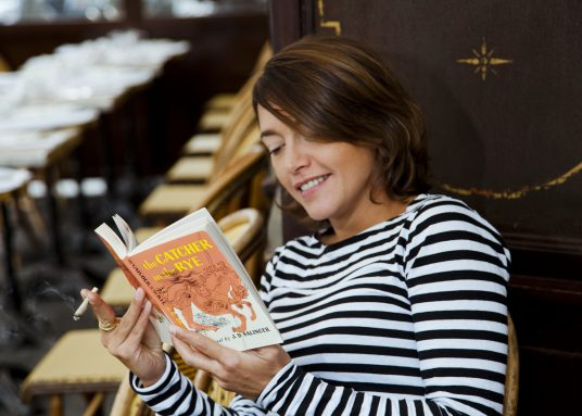 "Emma de Caunes reading ""The Catcher in the Rye"" Salinger, Paris, 2016 © Francesca MANTOVANI / READING WILD"