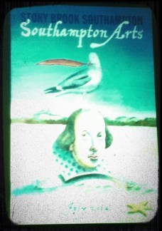 A flyer advertising Stony Brook Southampton Arts with Shakespeare's bust in the sand, a seagull perched on his head, and a feather in his mouth