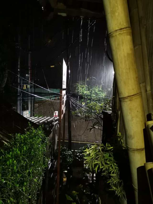The november tropical rain in Bali by night, view from Hubud co-working place.