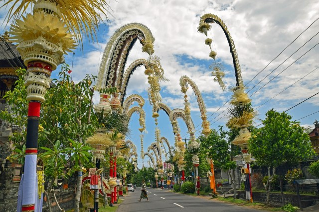 Bali tradition ceremony street during calungan and kuningan, penjor bamboo