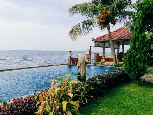 Hotel Wahyu Dana at Lovina Beach, Bali. An infinity pool facing the sea, with a dolphin as a fountain.