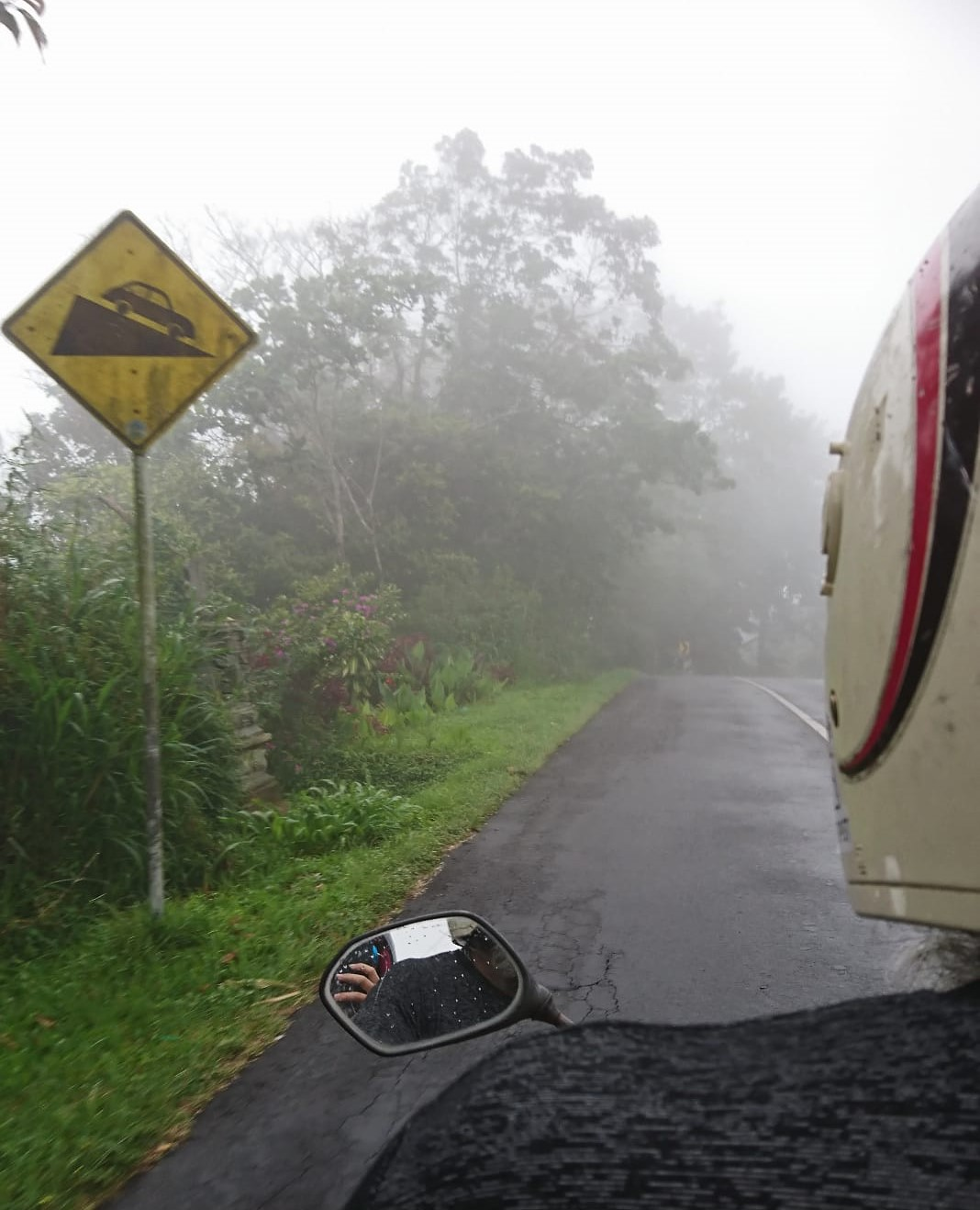 A scooter ride from a misty road between ubud and Lovina. Warning, steep descent.