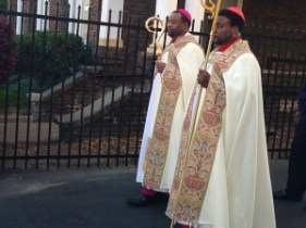 Eddie Long pictured in a silly Roman Catholic Attire to the front in the red Zuchetto