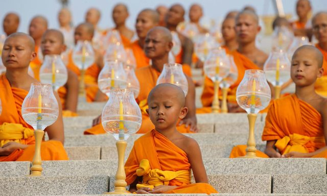 Young Buddhist monks deep in prayer and meditation!