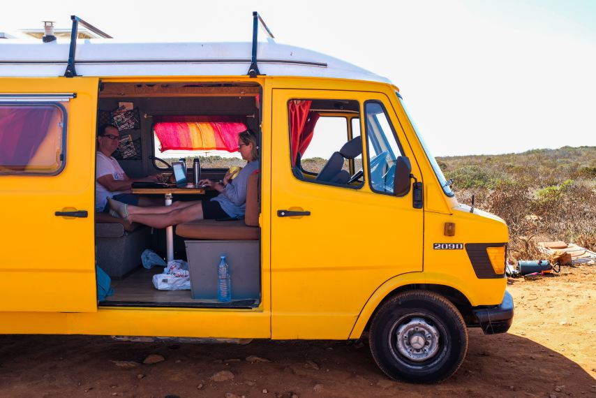 Digital nomads working in a campervan