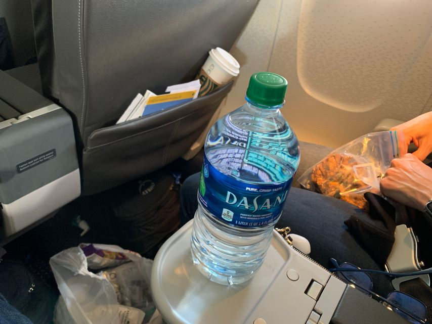 water bottle on airplane flying during COVID-19