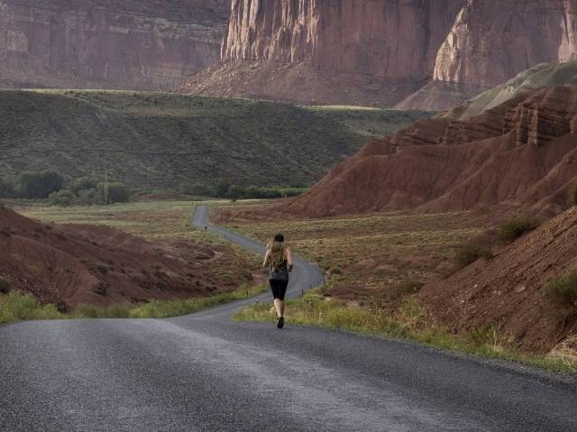 Woman running lots of miles training for a marathon.