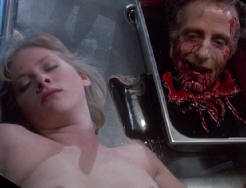 Barbara Crampton and David Gale in Re-Animator