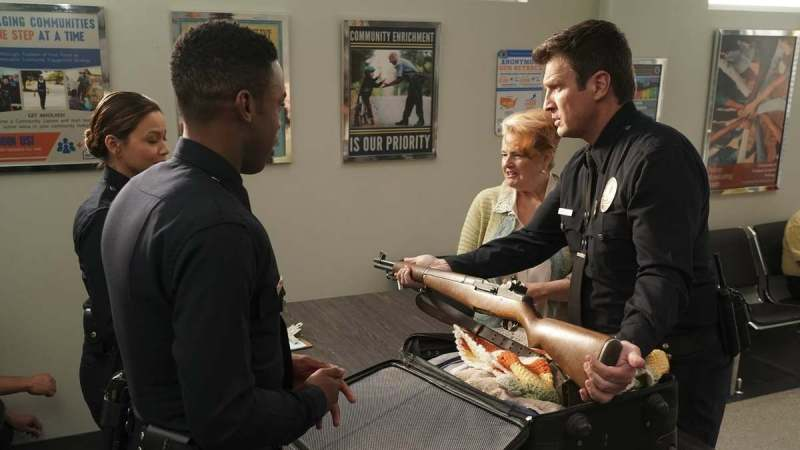 John Nolan handling old weapons in Redwood - The Rookie episode 11