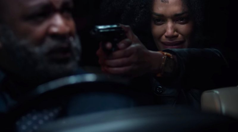 Queen Sono points a gun at Dr Sid in Queen Sono season 1, episode 5, - Sugar Water - Netflix