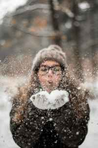 pexels photo 2254028 - woman blowing snow outdoors
