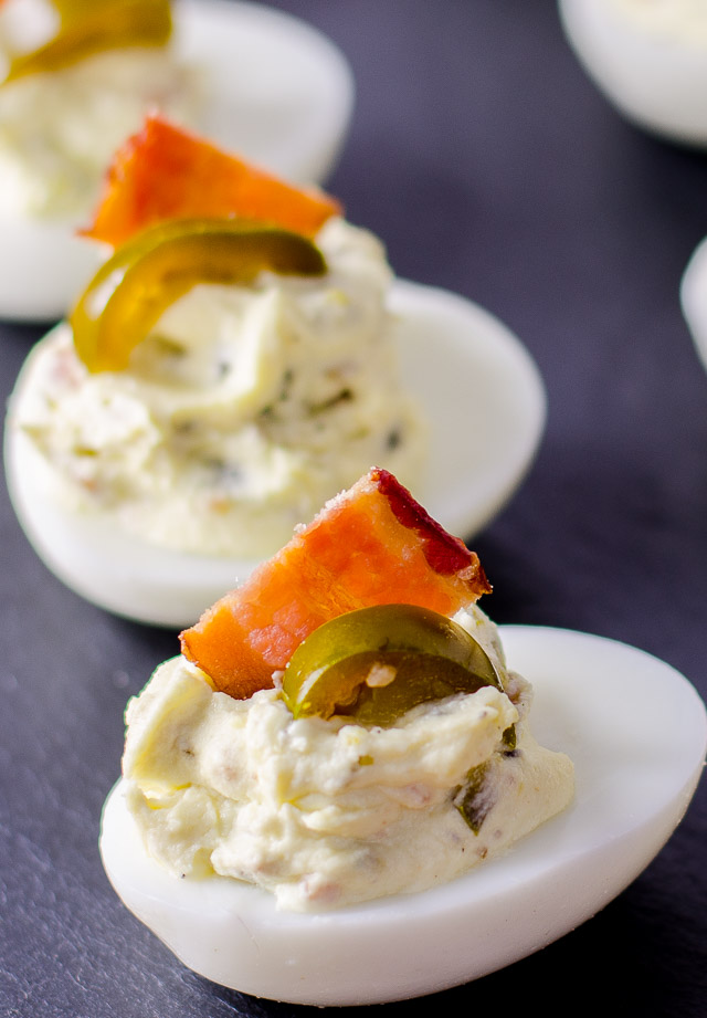These jalapeno bacon deviled eggs have a sneaky kick to them, plus a bacon crunch to satisfy your snacking needs!