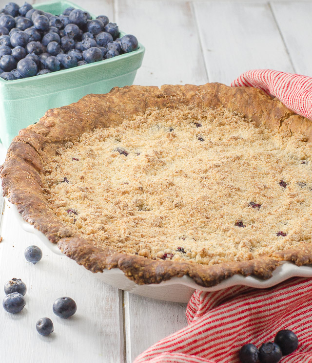 This blueberry crumb pie is perfectly juicy with a subtly spiced filling. The crispy brown sugar crumb puts it over the top!
