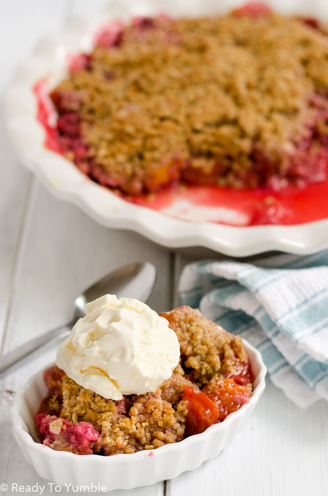 Nectarine Raspberry Crisp with Spiced Crumb Topping is packed with delicious summer fruit and covered in a flavorful, buttery crumb. Best served with a creamy scoop of ice cream on a warm night!