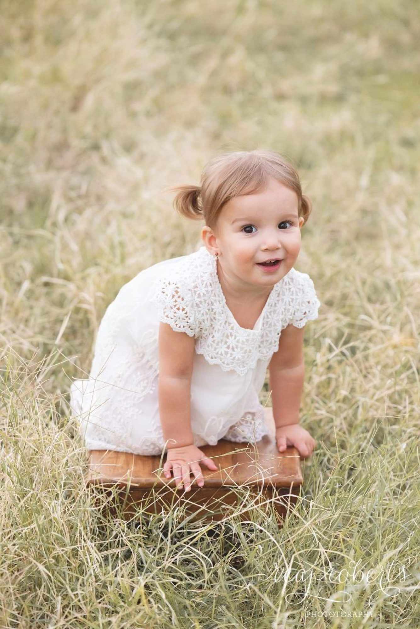 Chandler children and family photographer little girl in tall grass