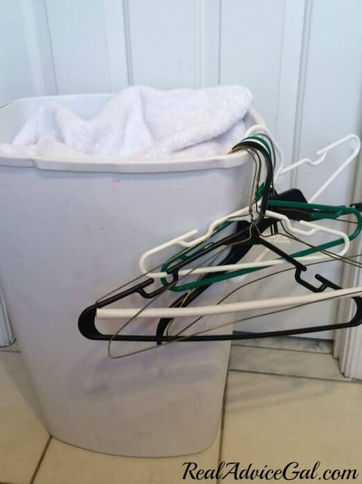 Real Advice Gal life hack when folding laundry hang your hangers on the side of the laundry basket