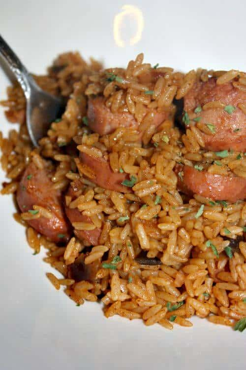 A super easy to make One Pot Jambalaya With Turkey Sausage Recipe. This is delicious and flavorful with creole seasoning, paprika, chicken broth, crushed tomatoes and more.