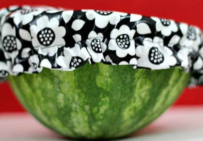 Use the bowl covers to cover half of a watermelon