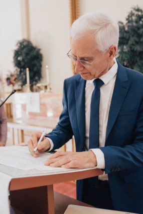 Darcie's dad signing marriage license St. Paul's Church San Diego