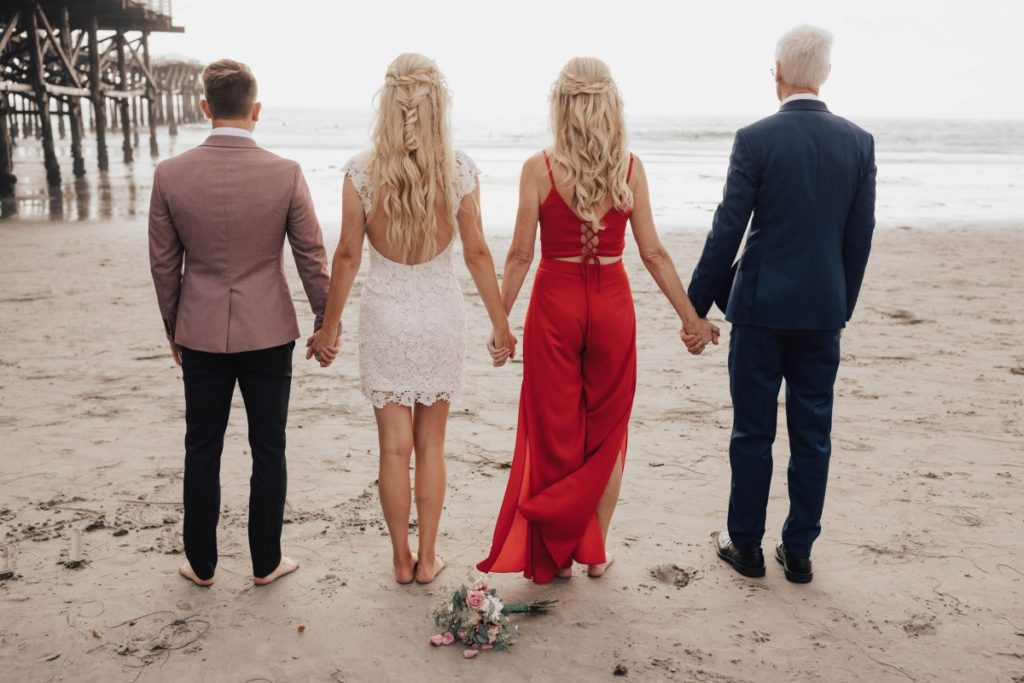 family wedding photo at beach in San Diego