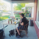 Jamie Long, Tim Brady and Dylan the Boxer in a front porch meeting