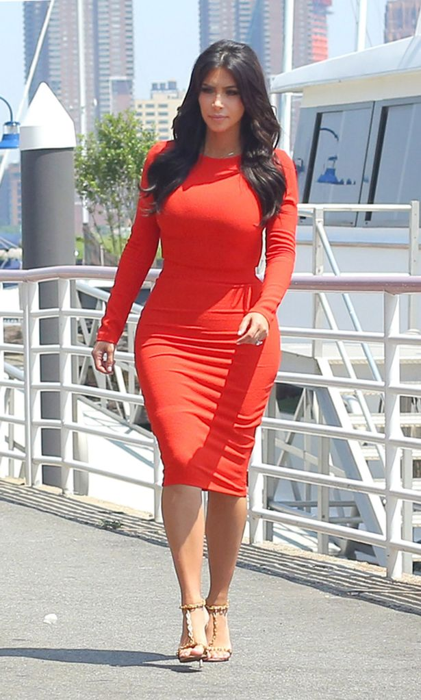 kim kardashian flaunts curves in two skin tight outfits as her and