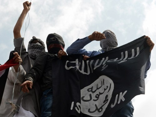 Kashmiri demonstrators hold up a flag of the Islamic State of Iraq and the Levant (ISIL) during a demonstration against Israeli military operations in Gaza, in downtown Srinagar on July 18, 2014. The death toll in Gaza hit 265 as Israel pressed a ground offensive on the 11th day of an assault aimed at stamping out rocket fire, medics said. AFP PHOTO/Tauseef MUSTAFA (Photo credit should read TAUSEEF MUSTAFA/AFP/Getty Images)