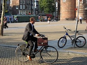 Another guy in a suit, this time with a briefcase - on a bicycle.