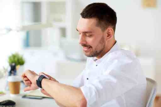 real estate professionals looking at watch