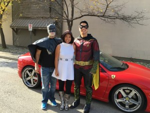 Princess Leia hanging out with batman and Robin on Halloween