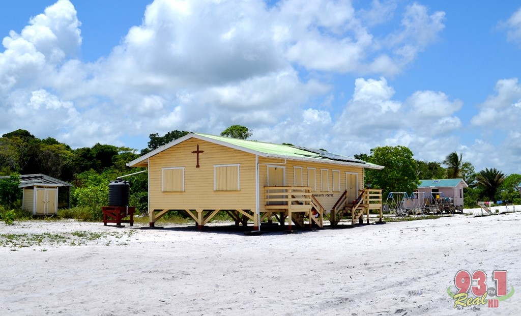 The community center stands in the white sand.