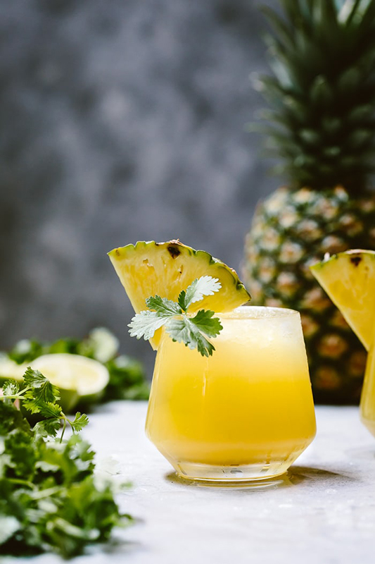 25 delicious ways to spice up National Pepper Month l spicy pineapple jalapeno mezcalita